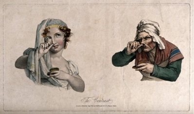 V0019116 A pretty girl and an ugly old woman both taking snuff. Colou Credit: Wellcome Library, London. Wellcome Images images@wellcome.ac.uk http://images.wellcome.ac.uk A pretty girl and an ugly old woman both taking snuff. Coloured lithograph, c. 1827. 1827 Published: August 1827 Copyrighted work available under Creative Commons by-nc 2.0 UK, see http://images.wellcome.ac.uk/indexplus/page/Prices.html