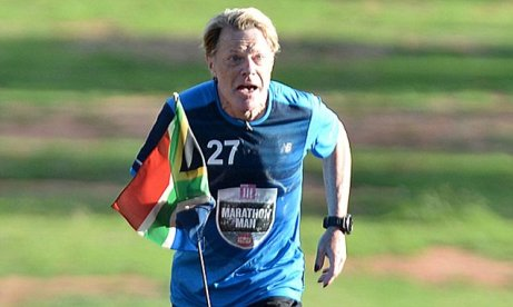British comedian Eddie Izzard completes his 27th marathon at the government's Union Buildings in Pretoria, South Africa, Sunday, March 20, 2016. Izzard has completed his challenge to run 27 marathons in 27 days for Sport Relief to remember the 27 years Mandela spent in prison. (AP Photo)