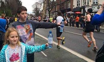 Spectators hand out water at the Sheffield half-marathon.