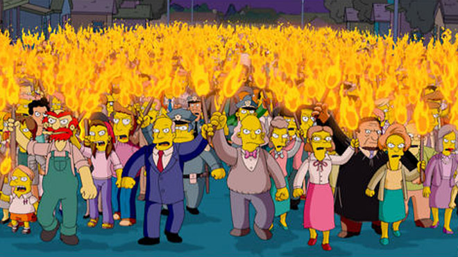 """In this animated image created by Matt Groening and released by Twentieth Century Fox, the entire town of Springfield is transformed into an angry mob, in a scene from """"The Simpsons"""" movie. (AP Photo/Twentieth Century Fox, Matt Groening)"""