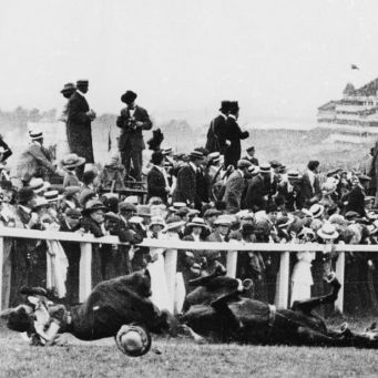Emily Davison (1872 - 1913) is fatally injured as she tries to stop the King's horse 'Amner' on Derby Day, to draw attention to the Women's Suffragette movement. (Photo by Arthur Barrett/Hulton Archive/Getty Images)