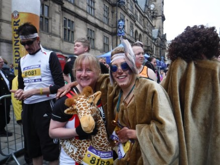 camel women and giraffe