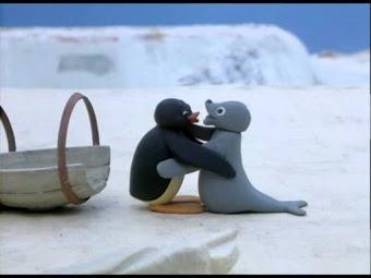 seal penguin hug