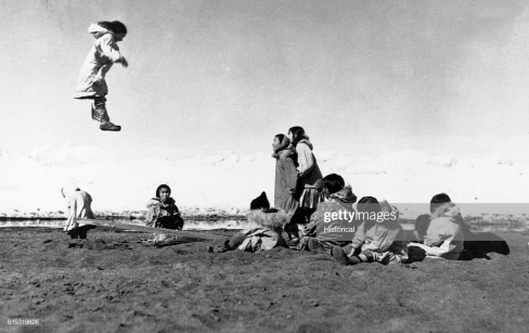 The Eskimo seesaw is much more rugged then the familiar version. (Photo by © CORBIS/Corbis via Getty Images)