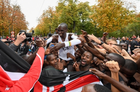 Free for editorial use and archive. Eliud Kipchoge celebrates with his pacemaking team, friends and supporters after crossing finish line to break the historic two hour barrier for a marathon. The INEOS 1:59 Challenge, Vienna, Austria. 12 October 2019. Photo: Thomas Lovelock for The INEOS 1:59 Challenge